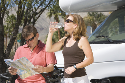 Couple On Cycling Holiday With Recreational Vehicle