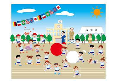 紅白に分かれ、大玉転がしをしている小学校の運動会