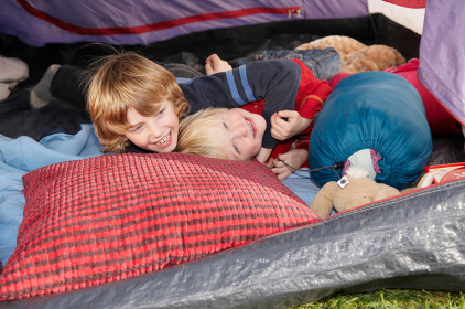 Boys playing of tent