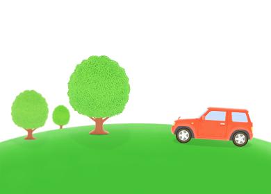 丘の樹木と赤いジープ