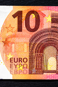 Selective focus on detail of euro banknotes. Close up macro detail of money banknotes, 10 euro isolated. World money concept, inflation and economy concept