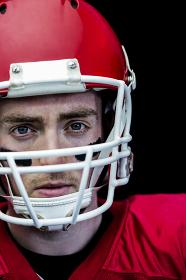 Portrait of focused american football player wearing his helmet