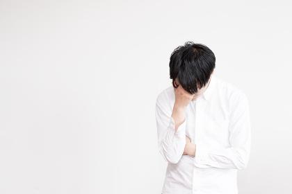 落ち込む男性(感情・失敗)
