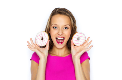 happy woman or teen girl with donuts