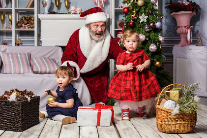 The two little girls with Santa at studio with christmas decorations