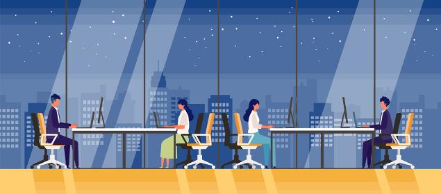ガラス張りの夜のオフィスで残業する人々