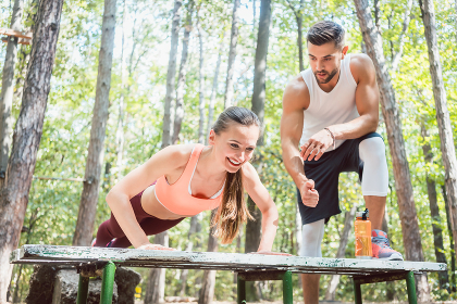 Sporty woman doing push-up in an outdoor gym