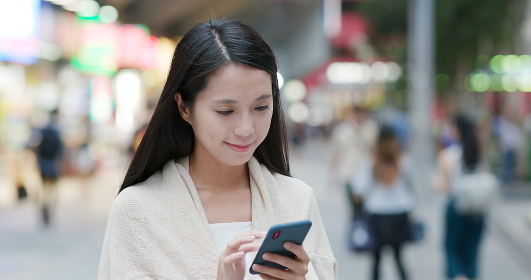 Woman use of smart phone in the city