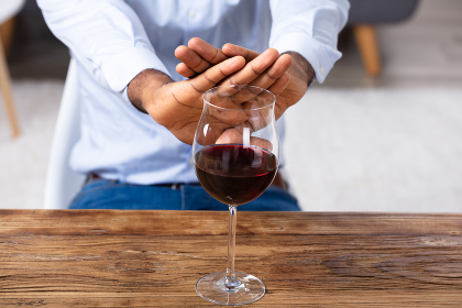 Man Making No Gesture For Glass Of Wine