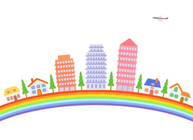 虹とマンションと家並み