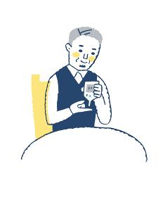 血糖値を測っているシニア男性