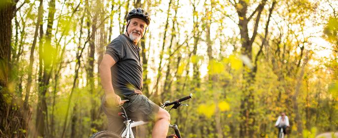 Senior man on his mountain bike outdoors (shallow DOF  color toned image)
