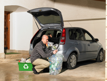 Man loading recycling into car