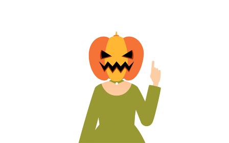 ハロウィンの仮装、カボチャのお化け姿の女の子が指さしをするポーズ