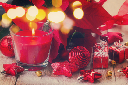 red  christmas candle  with balls and stars, retro toned