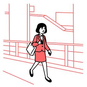 ビジネスシーン オフィス街を歩く女性