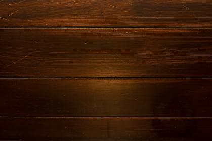 茶色の傷のある木目の背景画像