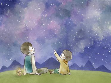 星空を見上げている父と息子