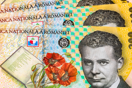 Selective focus on detail of lei banknotes. Close up macro detail of romanian lei banknotes, 200 lei isolated. World money concept, inflation and economy concept