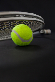 Close up of silver racket on tennis ball