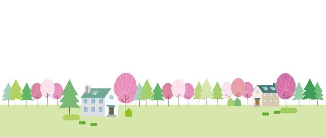 ピンク色になった花木がある田舎の風景