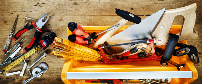 Colorful yellow tool box with DIY tools