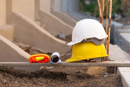 Hard hat on wooden board and blueprint building construction estate pr