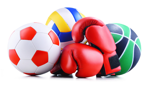 Three sport balls and boxing gloves over white background