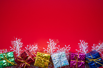 Christmas composition. Christmas gift on red background. Flat la