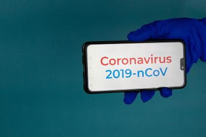 hand with syringe, coronavirus vaccine.