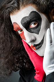 Joker with face mask in studio