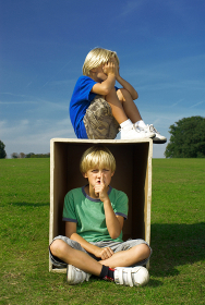 two boys playing with box