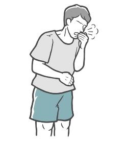 口を手で押さえて咳をする若い男性