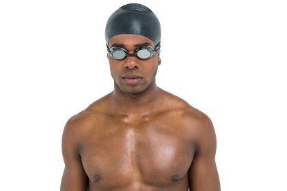 Swimmer in swimminggoggles and swim cap