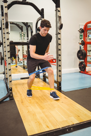 Fit man using resistance band