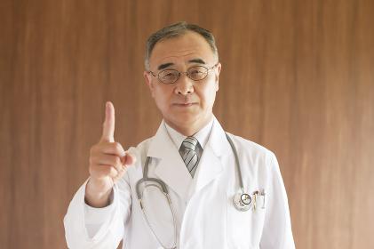 指差しをする医者