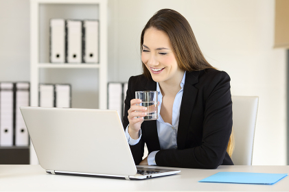 Office worker working holding a glass of water