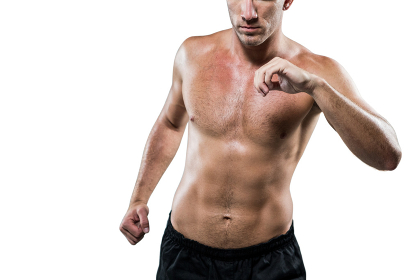 Midsection of shirtless athlete exercising