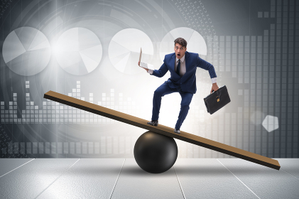 Businessman trying to balance on ball and seesaw. The businessman trying to balance on ball and seesaw