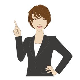 スーツ姿で指差しポーズをする女性会社員