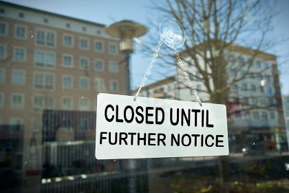 Sign on a shop window with the inscription closed until further notice