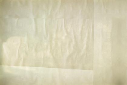 亜麻色のしわくちゃな紙の背景。貼り合わせた四角い紙。古めかしい汚れたテクスチャ。