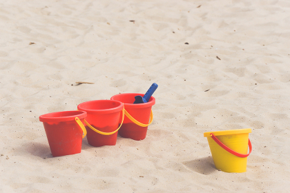 Kids toys in a sandbox in the summer