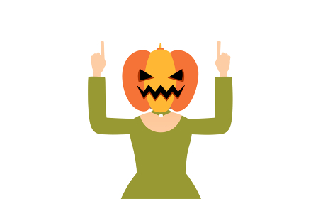 ハロウィンの仮装、カボチャのお化け姿の女の子が両手で指さしをするポーズ