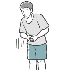 お腹に手をあてる腹痛の若い男性