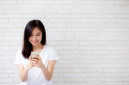 Beautiful of portrait young asian woman touch phone and smile st