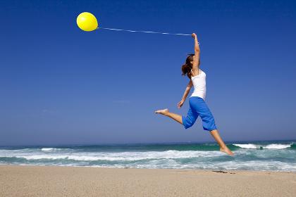Beautiful woman jumping with balloons , Caldas da Rainha, Leiria District, Portugal