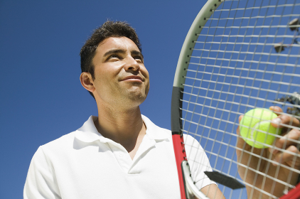 Male Tennis Player Preparing to Serve close up low angle view