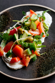 Italian salad with vegetables, olives and soft cheese