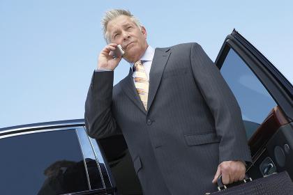 Serious Businessman Using Cellphone